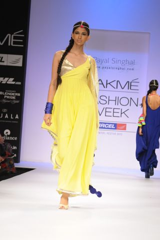 Acid Yellow Georgette Assymetrical Churidaar Kurta with Mukaish Dupatta. SHOP THE LOOK AT http://www.payalsinghal.com/off-the-runway/acid-yellow-mukaish-suit