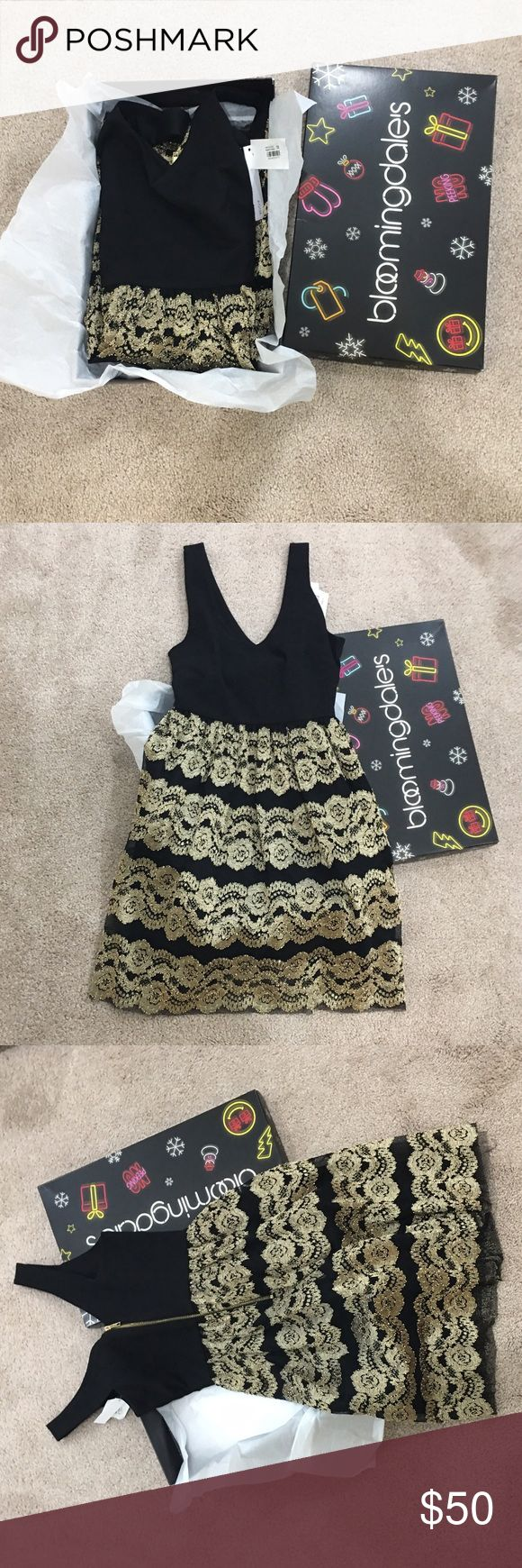 New in box Aqua Dress XS Purchased from Bloomingdales.  Still in box with tags.   Too late to return.  Colors are gold and black.  Zipper closure in back. Works perfectly.  XS, runs true.   Will ship with box.  Fits a little below the knee. Aqua Dresses Midi