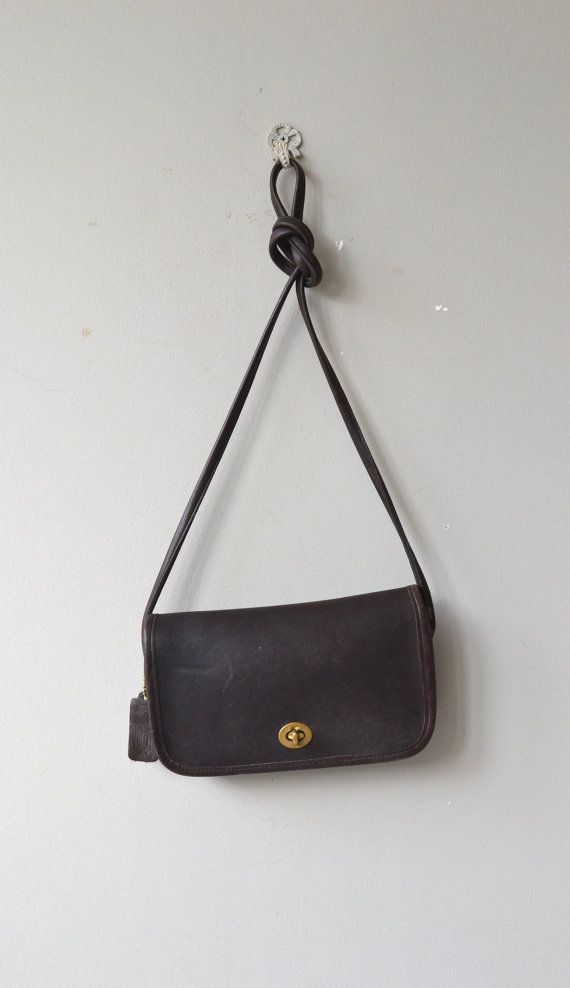 Vintage Coach leather shoulder bag in dark brown leather, flap closure, brass hardware and long, cross-body strap.  --- M E A S U R E M E N T S ---  9