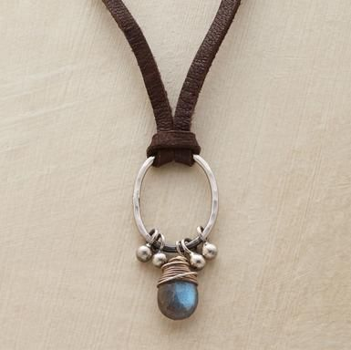 """Knotted on soft suede, a hammered sterling oval suspends a pear-shaped labradorite pendant and silver barbell beads. Sterling silver hook clasp. Imported. 15""""L."""
