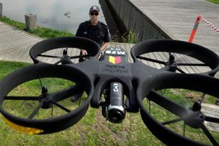 Drones To Fight Fires | Firies show off $30,000 flying drones, equipped with high-definition cameras and thermal imaging, to help battle fires this summer. [The Future of Drones: http://futuristicnews.com/tag/drone/ Drones for Sale at Amazon: http://futuristicshop.com/tag/drone/]