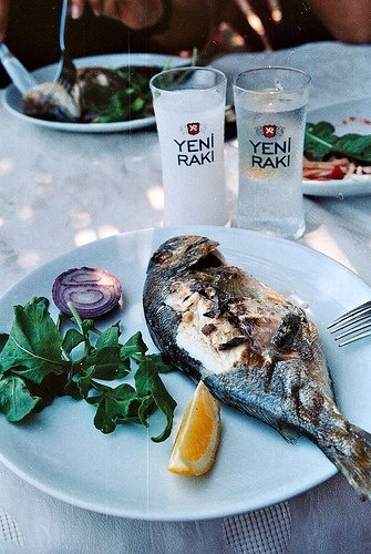 Turkey: Rakı and grilled fish, preferably with lots of meze, too.
