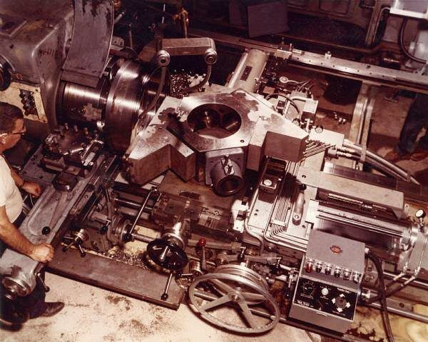 Man working on a turret lathe inside the Gisholt Machine Company. That's quite the turret assembly