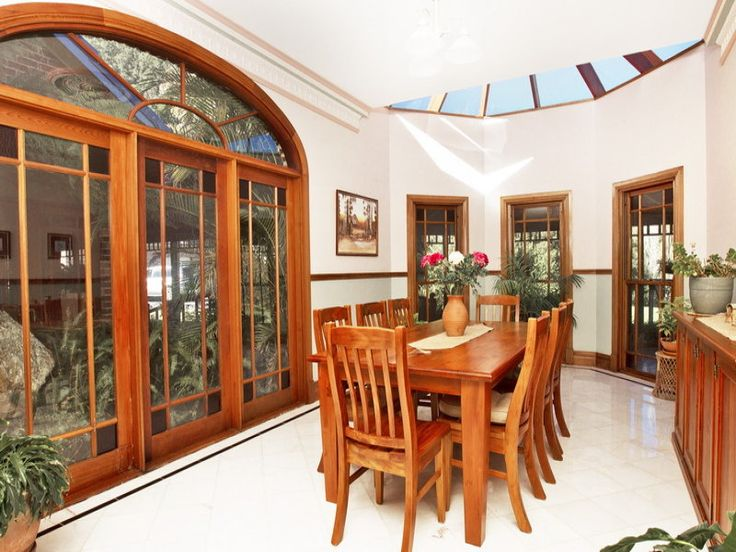 Classic dining room idea with hardwood & floor-to-ceiling windows - Dining Room Photo 1368168