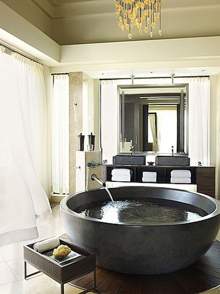 Elegant And Exotic Round Black Stone Bathtub. Also Has Unique Plumbing  Fixtures And Magnificent Wood Flooring Underneath Tub. This Is A Bathtub We  Dream ...