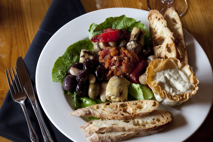 Delicious après ski abounds in Big Sky: house made Boursin cheese in filo cup, warm Sicilian olives, roasted garlic, char-grilled artichoke, roasted sweet bell pepper, olive oil cured button mushroom, eggplant caponata, crisp baguette.