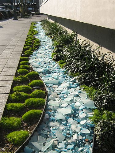 add sea glass to the seashells inside the front patio wall