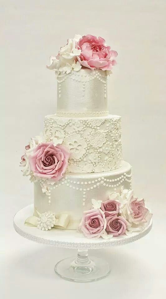 Stunning ivory lace and dusky pink rose triple tier cake. Beautiful for all special occasions x