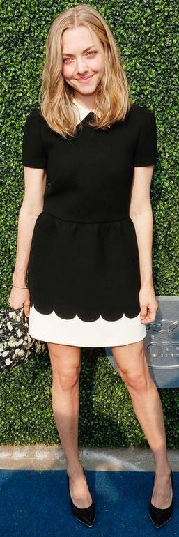 Who made Amanda Seyfried's black print clutch handbag and white short sleeve scallop dress?