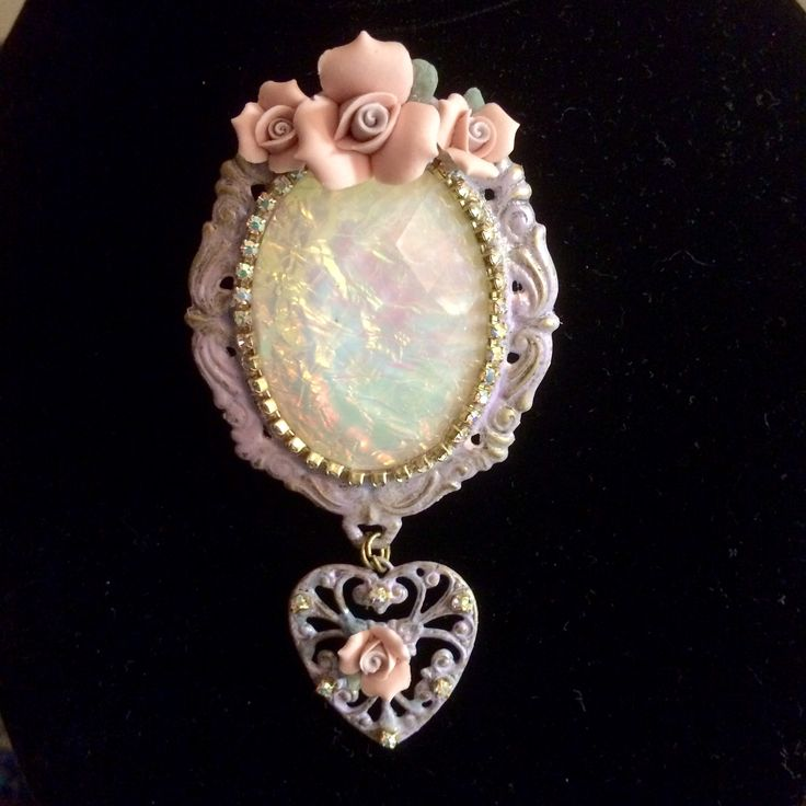 Brooch with faux opal stone with heart