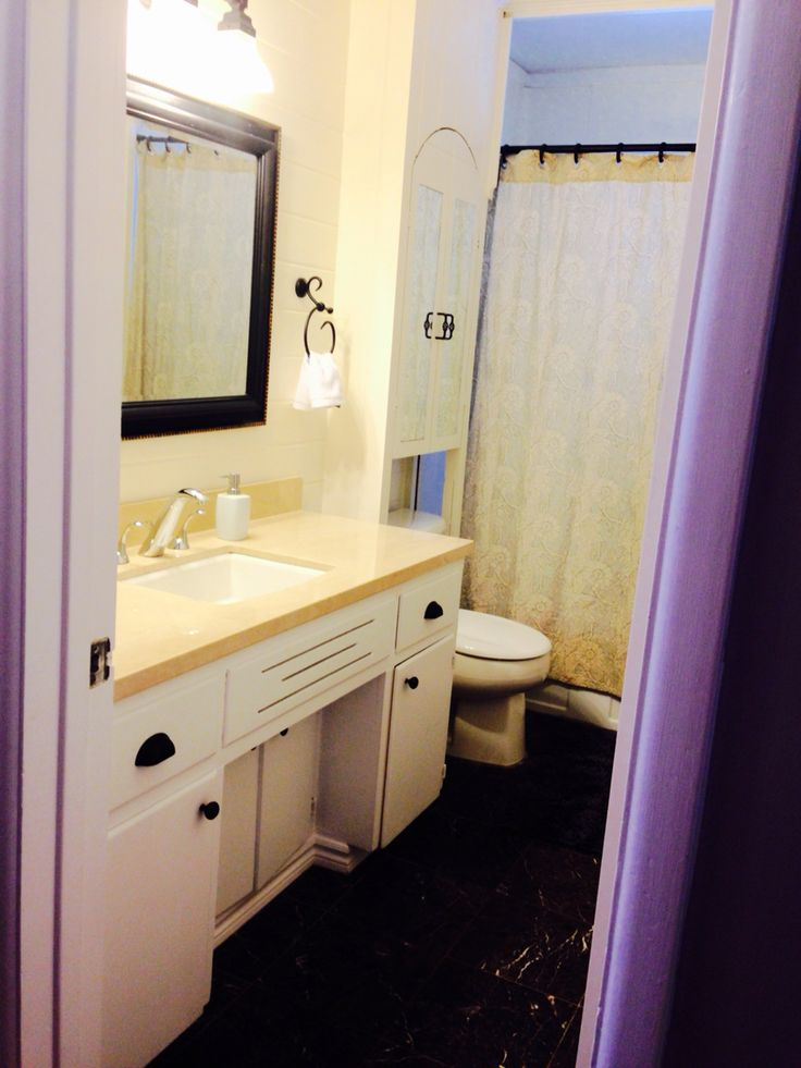 Cape cod Bathroom with marble vanity top and tile floor