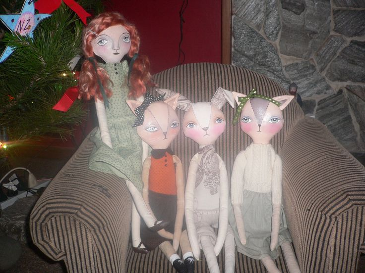 All the dollys sitting under the christmas tree waiting to go to their new homes
