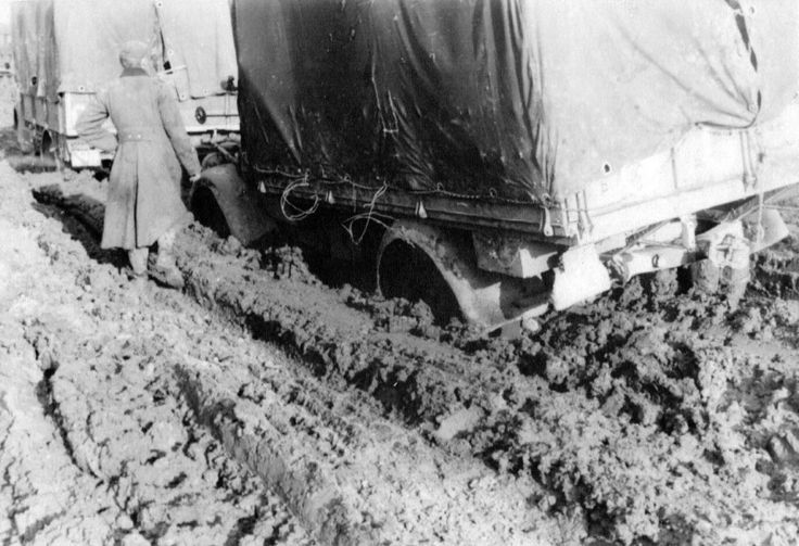 "Russian roads WW2. German soldiers near stuck in mud trucks Opel ""Blitz"" (Opel Blitz)."