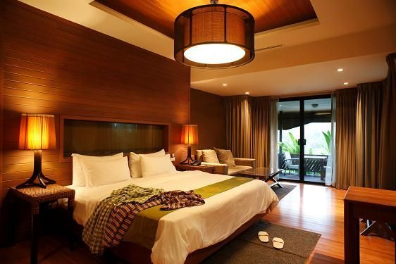 This bedroom embraces the natural beauty of local wood.