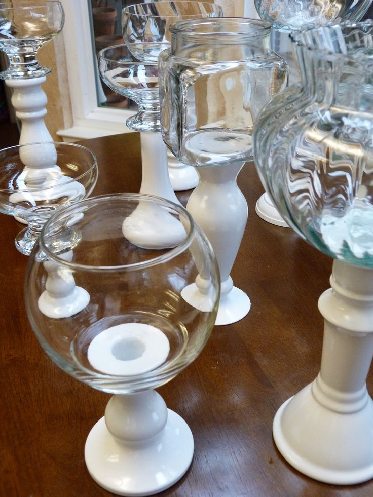 Spray painted candlesticks glued to jar bottoms with or without lids for candy bar buffet. Classy!