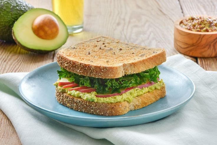 Sandwich: Spread mashed avocado evenly among 4 bread slices. Top with apple slices and Kale Salad. Cap with remaining bread slice. Serve immediately.