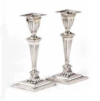 A pair of Dutch silver candlesticks  Mark of Anton Hendrik Paap, Amsterdam, 1805, also struck with later Dutch duty marks; the nozzles with later Dutch duty marks  Each on lozenge-shaped and stepped, reeded and beaded foot, the high-domed and canelled centre rising to a tapering stem and vase-shaped socket ensuite and a detachable conforming beaded nozzle, marked on footrims, sockets and nozzles  21 cm. high  590 gr. (2)