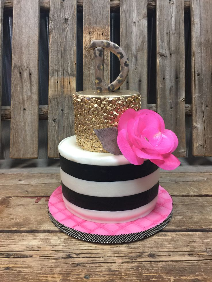 Girly girl cake, with leopard monogram and wafer flower.