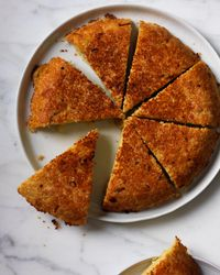 Couscous Galette: This big, cheesy couscous cake is a wonderful way to use up leftovers, but it's so good and fast you'll want to make it with fresh couscous, too. Grace Parisi sometimes adds whatever roasted vegetables she has on hand, such as sweet potatoes, carrots or asparagus; or she might top the galette with fried eggs for breakfast.