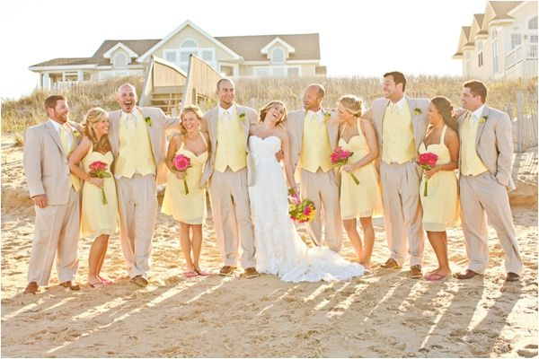 light yellow bridesmaid dresses, pink gerbera daisy bouquets, classic men's beach attire, beige suits, light yellow silk vests and ties, sperry top siders, stylish beach bridal party, yellow and pink beach wedding, Macon Photography
