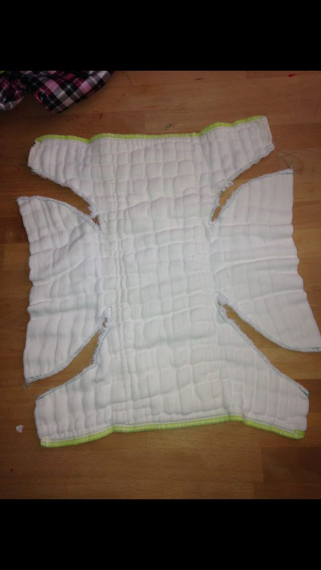 DIY fitted diapers - cut a prefold and surge the edges. I love how they didn't completely cut out the leg holes, so they can be folded in for extra absorbency.