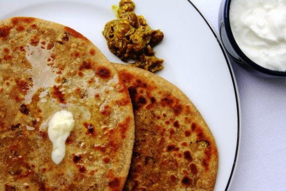 Gobi ke parathe: Indian flat bread stuffed with spiced cauliflower and fried in butter