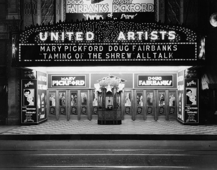 united artists theater night view showing lighted marquee