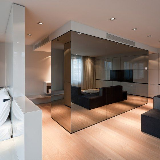 mirrored glass wall to separate the ensuite from the bedroom -Sana Hotel Berlin