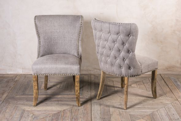 French style upholstered dining chairs with studwork and buttoned backs. Available in three finishes. Large quantity in stock now. Perfect for restaurants.