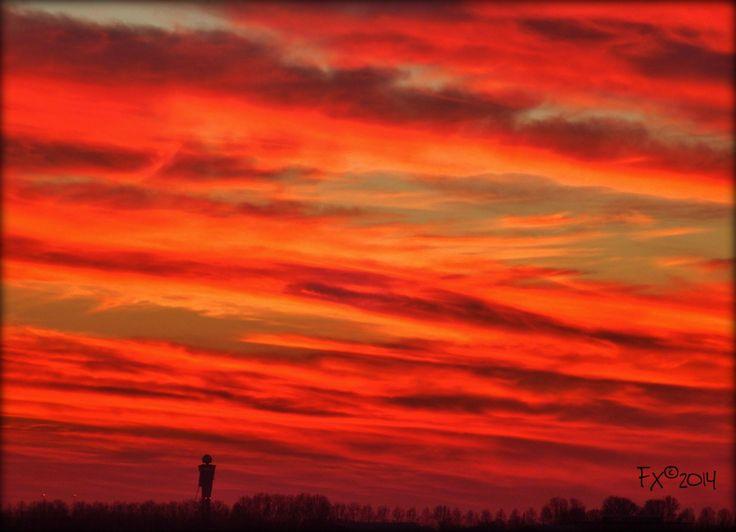 Schiphol in orange clouds