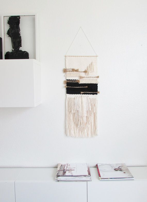 This stylish wall hanging is made by hand . Off white cotton and wool yarns, black cotton and a lot of texture bringing a beautiful chic and natural