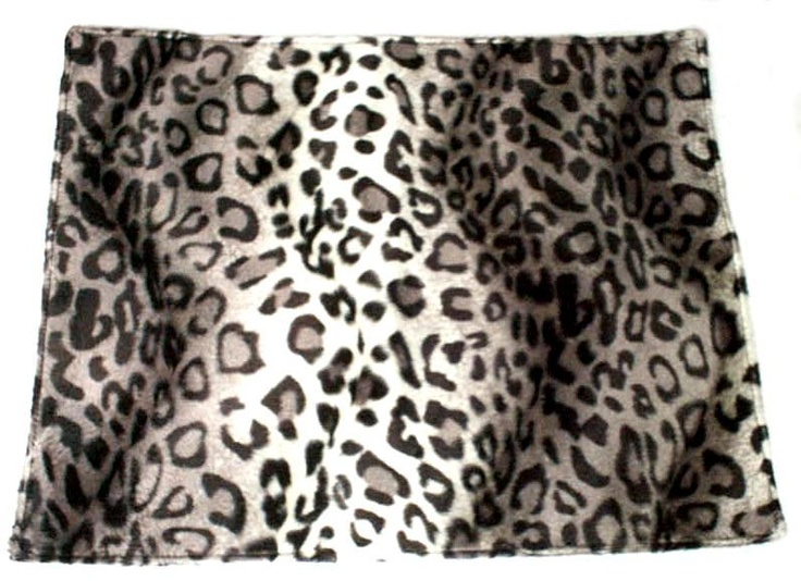 Snow Leopard Placemat. The placemat is reversible, with a solid black Faux Suede.100% Polyester. Sold in sets of four. $74.