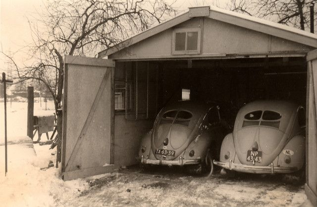 Snug as a Bug in a .......Garage! VW Split window black and white pic.