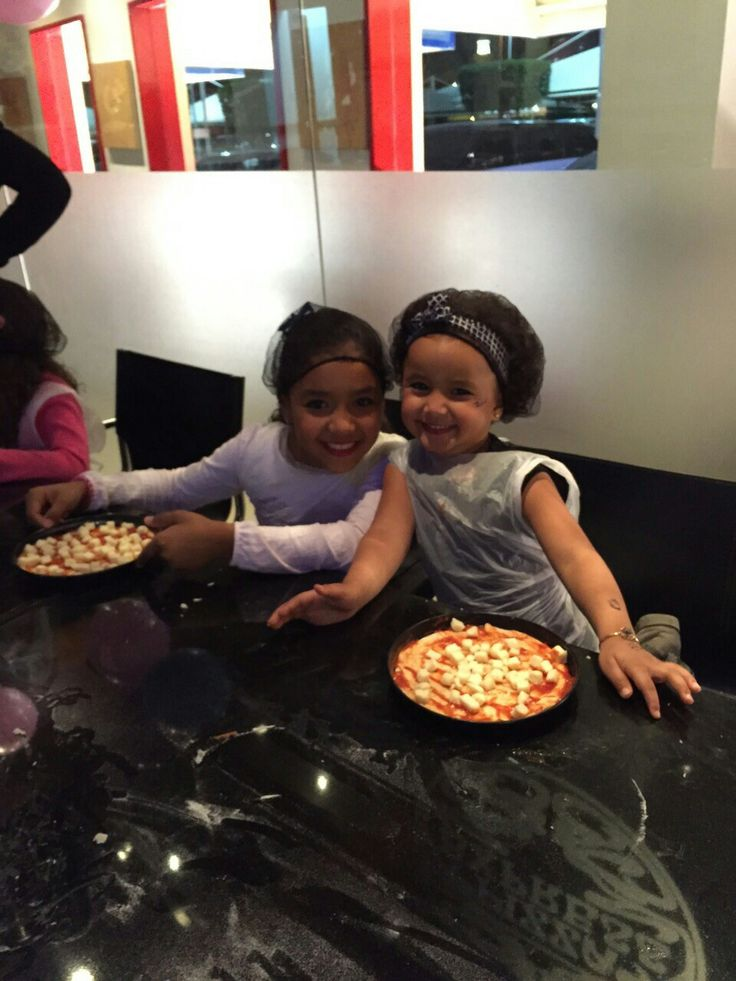 With my small sis doing pizza