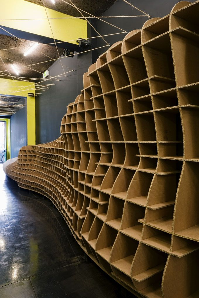 cardboard shelving for bar/shop LOW in Lisbon, Portugal. designed by Pedro Campos Costa http://www.camposcosta.com/ #environmental #paper #shelving #organization #interior_architecture