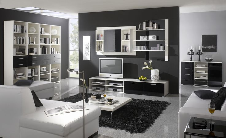 Never underestimate the power of a black and white colour scheme! Popular #Niemann's surfaces give this #livingroom real #impact.