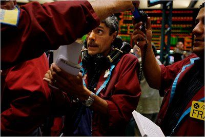 """FOLLOW THE BOUNCING OIL PRICE:  """"""""One day they're up; the next they're down. No one can predict where oil prices are going, but millions of people are willing to make a bet on them every day. Ben Lopez, a trader with SCS Commodities, uses multiple phones while working in the oil futures pit of the New York Mercantile Exchange, located in Lower Manhattan.""""  ~  Prepare to be Wrong: September 2008; (Photo: Ruth Fremson/The New York Times)"""