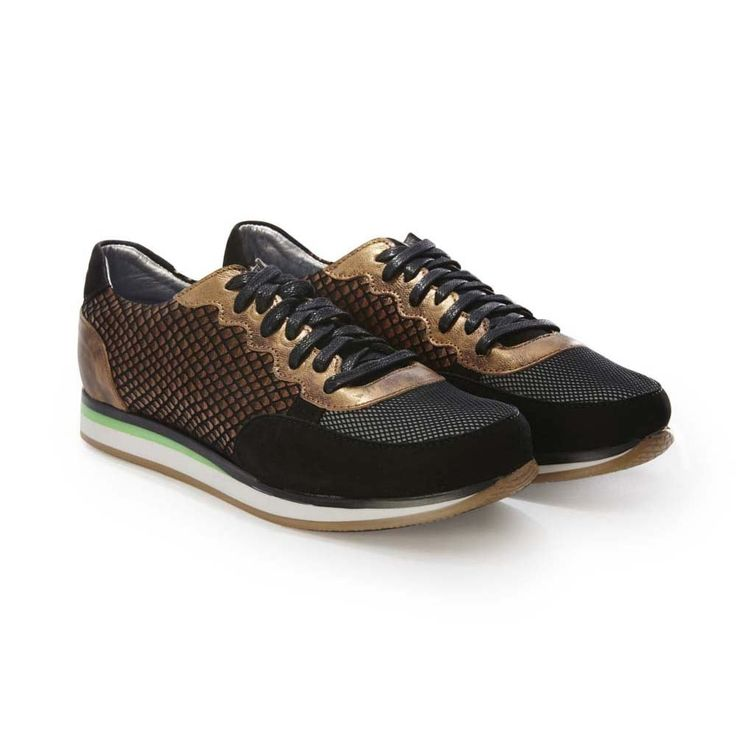 Rose Rankin Black and Copper Colt Runner Sneaker: Rose Rankin Black & Copper Colt Runner Sneaker. Casual, cool, and beautifully made, we're long time fans of Rose Rankin sneakers. Wear alongside casual pieces or add a contrast to a dressier look.