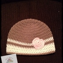 Simple girls toque, tan and cream stripes with a pink heart.  Perfect as a Valentine's Day hat or just the perfect hat for your sweetheart.  Fits approximately a 3-10 year old.