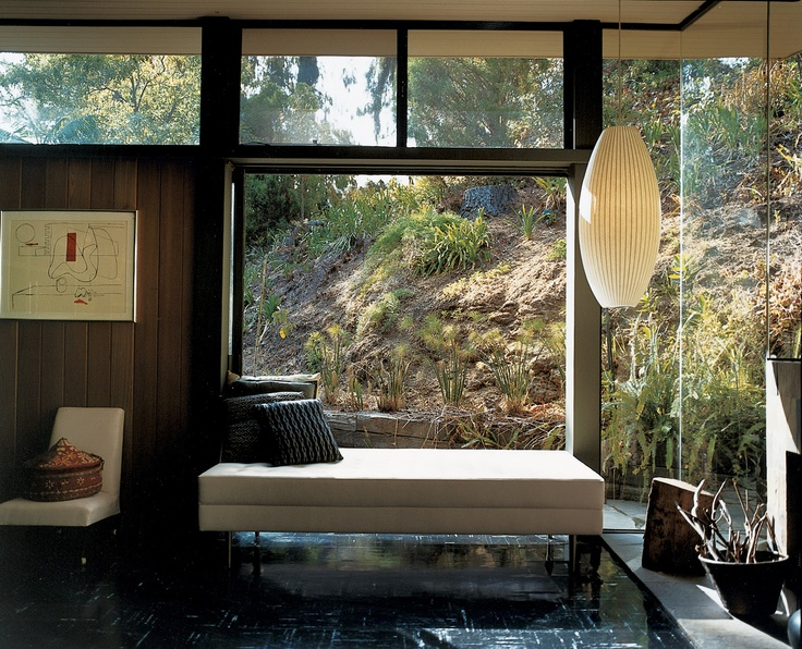 The Mutual Housing Assn site office | renovated into home by Cory Buckner and Nick Roberts. Mid-Century modern--tons of windows, minimalist lounge seat and simple hanging lamp. Love the view.