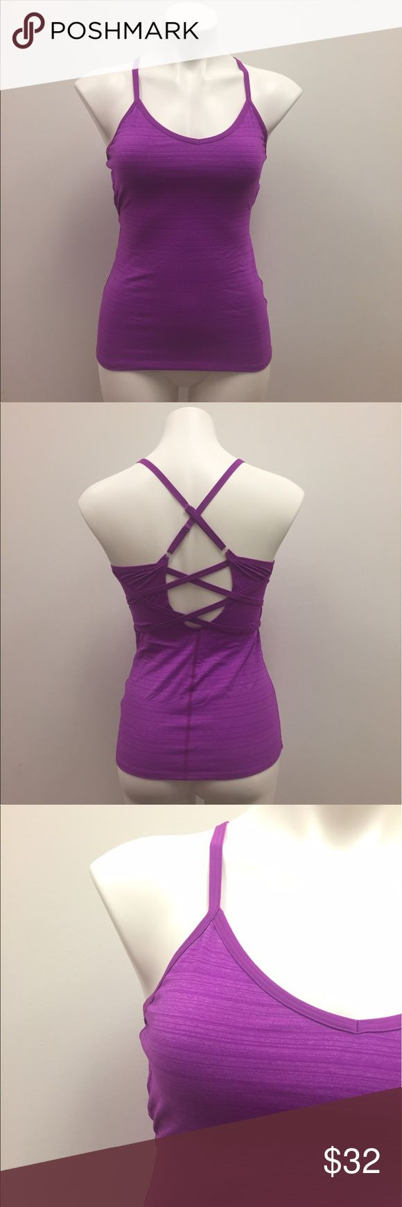 Beyond Yoga Bright Purple Workout Tank Gorgeous bright purple workout tank from Beyond Yoga in a size medium. It has a subtle pattern to it and is in very good condition with light wear! It has a chic/trendy back criss cross detailing sure to make a statement in your workout or when you are out and about on the go! #beyondyoga #purple #athletic #athleisure #workout Beyond Yoga Tops Tank Tops