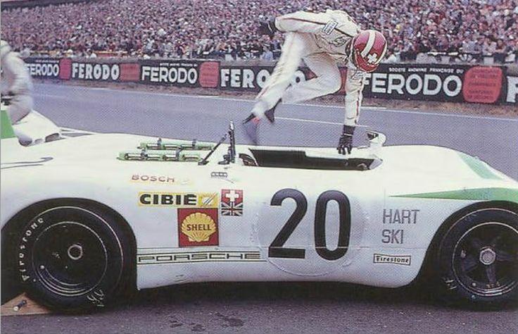 Joe Siffert jumps into his Porsche 908 spyder
