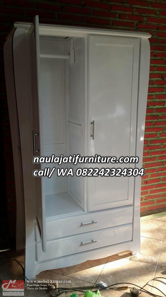 Model lemari pakaian minimalis dengan desain modern warna putih finishing cat duco , lemari pakaian minimalis 2 pintu untuk anak anak sangat laris di tahung ini.