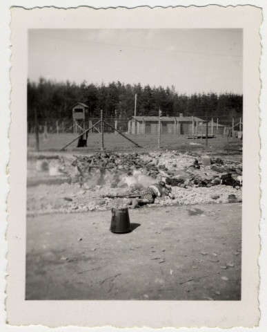 "Bodies and bones of dead prisoners lie piled near the fence of the Landsberg concentration camp. The original caption reads: ""Dead burning Jews of concentration camp in Landsberg, Germany"". [Photograph #71955] Date:	Sunday, April 29, 1945 - Wednesday, May 02, 1945  Locale:	Landsberg, [Bavaria] Germany  Credit:	United States Holocaust Memorial Museum, courtesy of Albright College  Copyright:	United States Holocaust Memorial Museum"