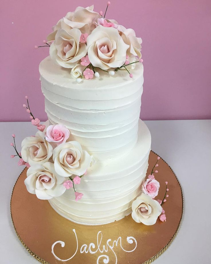 A beautiful buttercream bridal shower cake with sugar flowers.