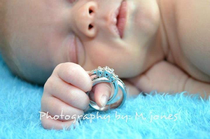 16 day old Jace with mommy & daddy's wedding rings <3