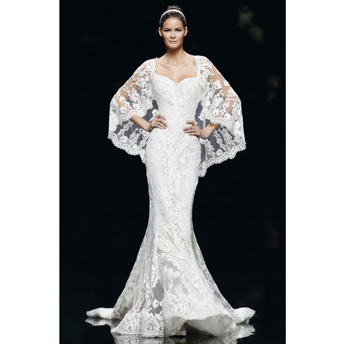 """Brides: Manuel Mota - Spring 2013. """"Vereda"""" strapless Guipure lace mermaid wedding dress with a sweetheart neckline, paired with a matching lace cape, Manuel Mota"""