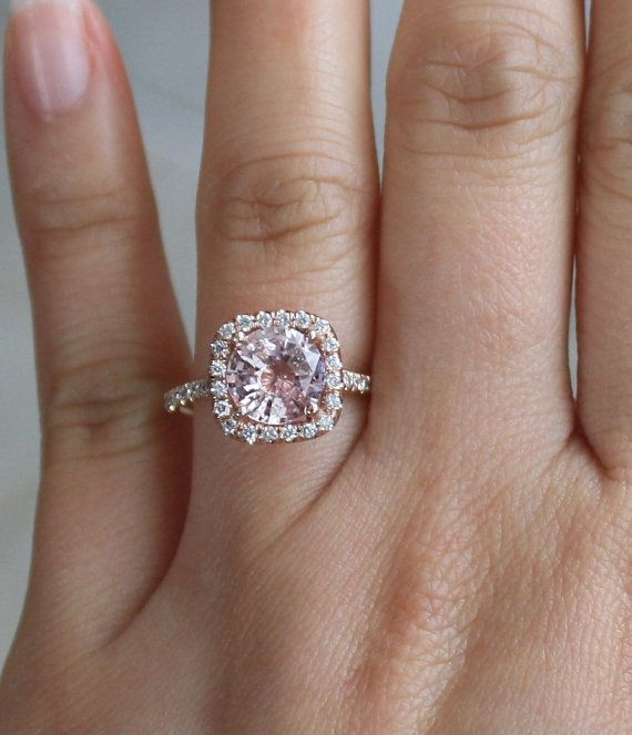 Big honker.! Pretty ring. https://www.etsy.com/listing/180152907/20-cts-champagne-pink-sapphire-diamond