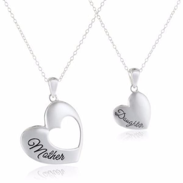 """Are you a Mother or Daughter? Then this necklace is perfect for you! The necklace has an 18"""" Chain.The Mother Pendant is 1"""" by 1"""" and the Daughter Pendant is 1/2"""" by 1/2"""". Buy one for yourself or give it as a gift to that special Mother or Daughterin your life."""