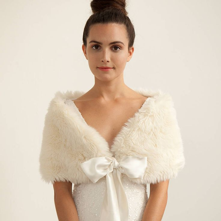 A gorgeous faux fur stole in ivory.This stole has been made using a high quality, long pile, faux fur in ivory. It's lined in a matching silk satin backed crepe in ivory and has ties made from the same satin backed crepe. The ties are adjustable and simply tie into a bow, so one size fits all. This stole will keep you warm yet ensure you still look glamorous. Perfect for Winter weddings. Your piece will come boxed and beautifully wrapped iin acid free tissue paper.Faux fur and ivory silk…